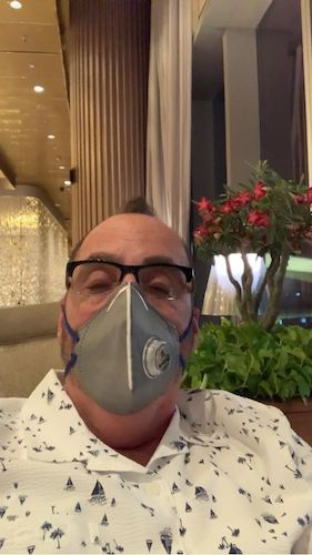 Traveling during COVID 19 - Gate 1 Travel - Gate 1 Travel India - Chuck wearing protective mask - keeping safe while traveling