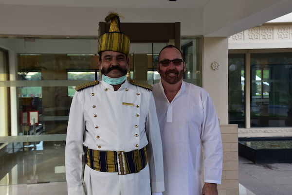 Agra - Trident Agra - Trident Hotels - Ragasthan - Rajasthani mustache - hotel doorman - hotel doorman removes mask for a photo - Chuck with hotel doorman