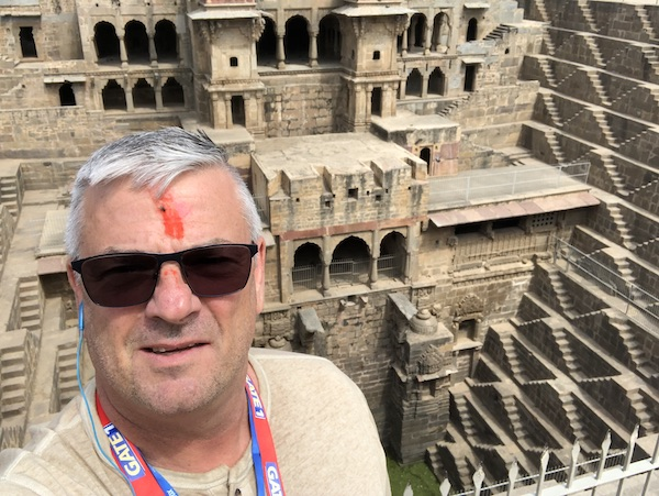 Abhaneri – Rajasthan – Ancient City of Abeneri - Mark at the Chand Baori - Mark at the Chand Baori step well - Gate 1 Travel - Chand Baori  - Chand Baori Stepwell - Mark and Chuck's Adventures