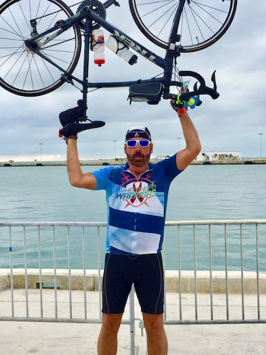 Mark and Chuck's Adventures - Chuck - Chuck completing Smart Ride - Smart Ride - Key West - Miami to Key West bike ride - bicycle - Chuck holding bicycle over his head