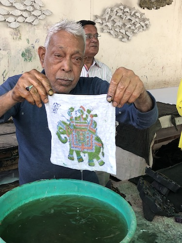 India Travel Blog – Jaipur Handicrafts – Jaipur India - India - block printing on fabric - artisan shows us a multicolor block print