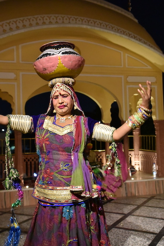 Rajasthani dancer- dancer balancing bowl on her head - dancer wearing traditional Rajasthani clothing