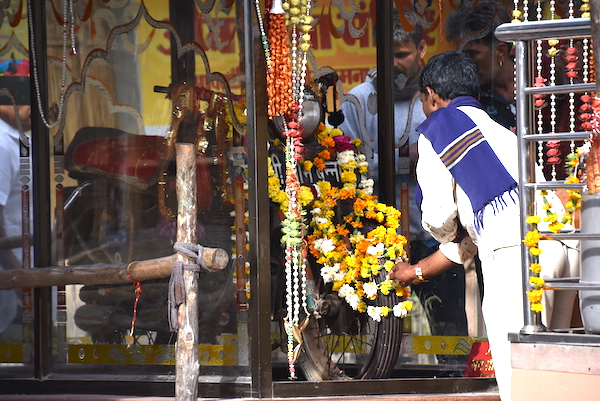 Travelers leaving floral garlands at the Shri Om Banna shrine