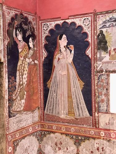 handprinted pink wall murals of Rajasthani women