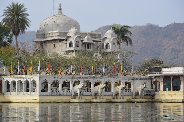 White marble elephant lining the edge of the Jag Mandir in Lake Pichola