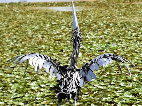 metal sculpture of a crane in Lake Maggiore in St Petersburg Florida