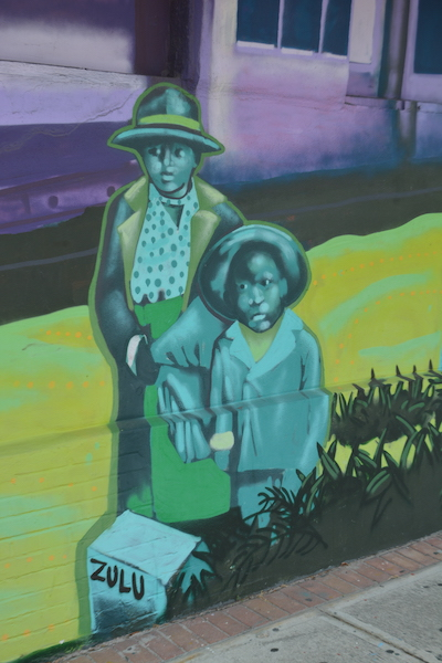 two black woman are part of a mural of black history in south St Petersburg Florida along the deuces