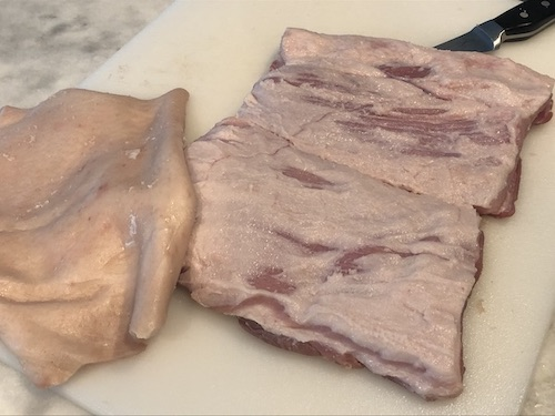 pork belly with the skin removed and cut in two pieces for curing