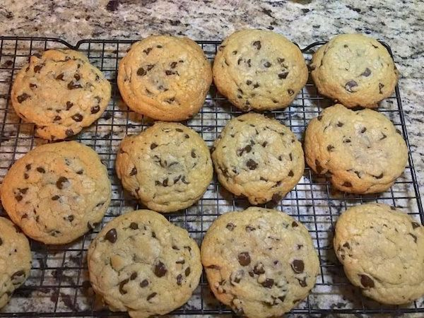 a batch of Mark's chocolate chips cookie recipe cooling on a rack
