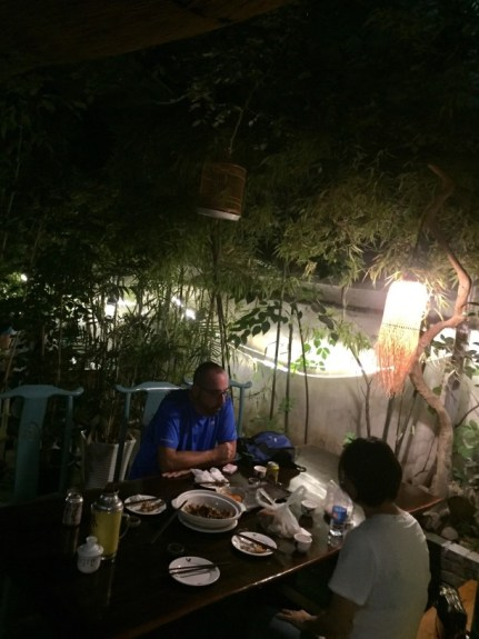 Chuck eating dinner in a secret garden in Xian on our Lost Plat Food Tour