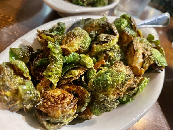Crispy fried brussel sprouts another one of the unique eats at Mimi Blue in Carmel Indiana