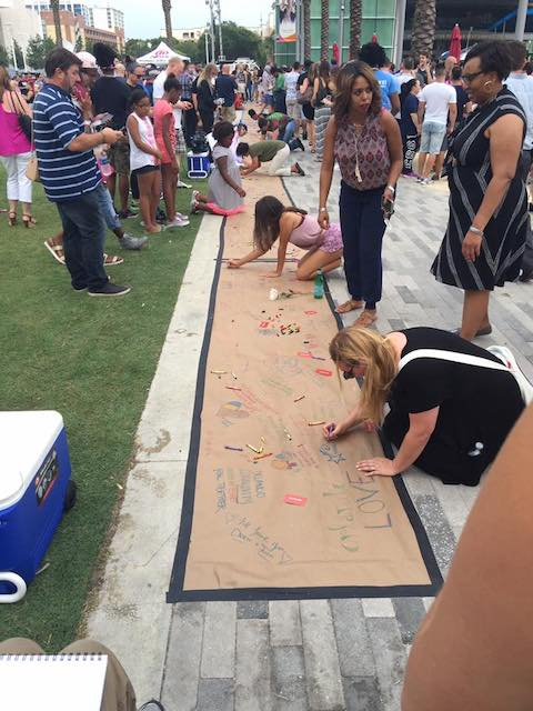 people writing messages of home and love after the PULSE massacre