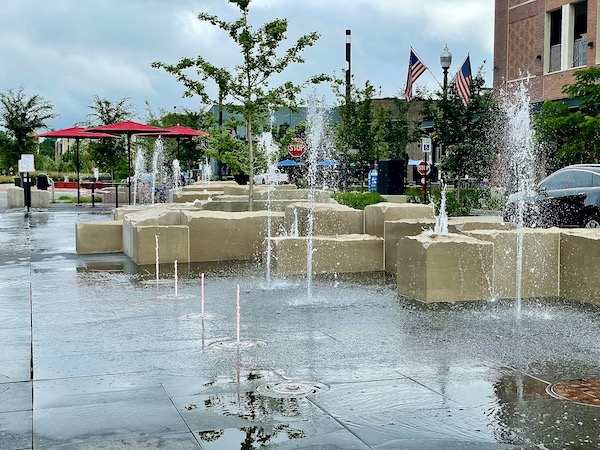 a water feature and seating along the Monon Trail in Carmel Indiana