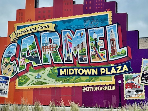 colorful postcard sign in Carmel Midtown Plaza