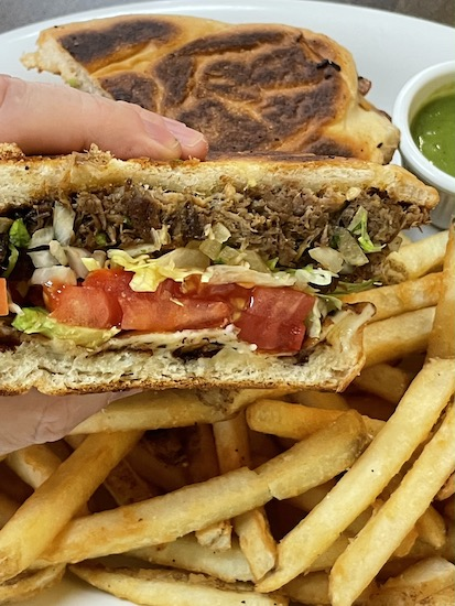 Barbacoa Torta with Fries and Salsa Verde at Reyna's Taqueria  in Sarasota