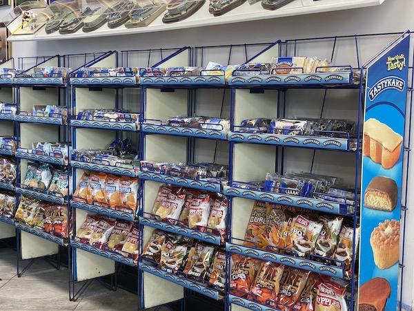 shelves of Herr's Chips, Tastykakes and sports memorabilia fill Delco's Original Steaks and Hoagies in Dunedin Florida