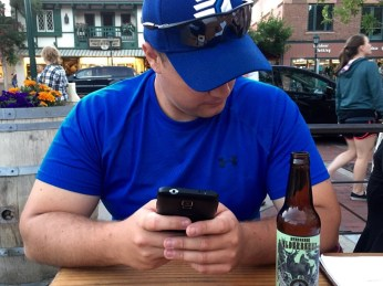 George texts local beer offerings to his craft expert back home.