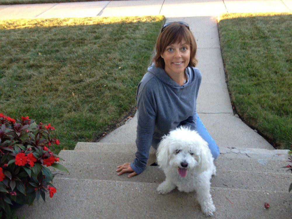 Breast cancer patient Amy Czerniec with Brichon Frise dog Caspar