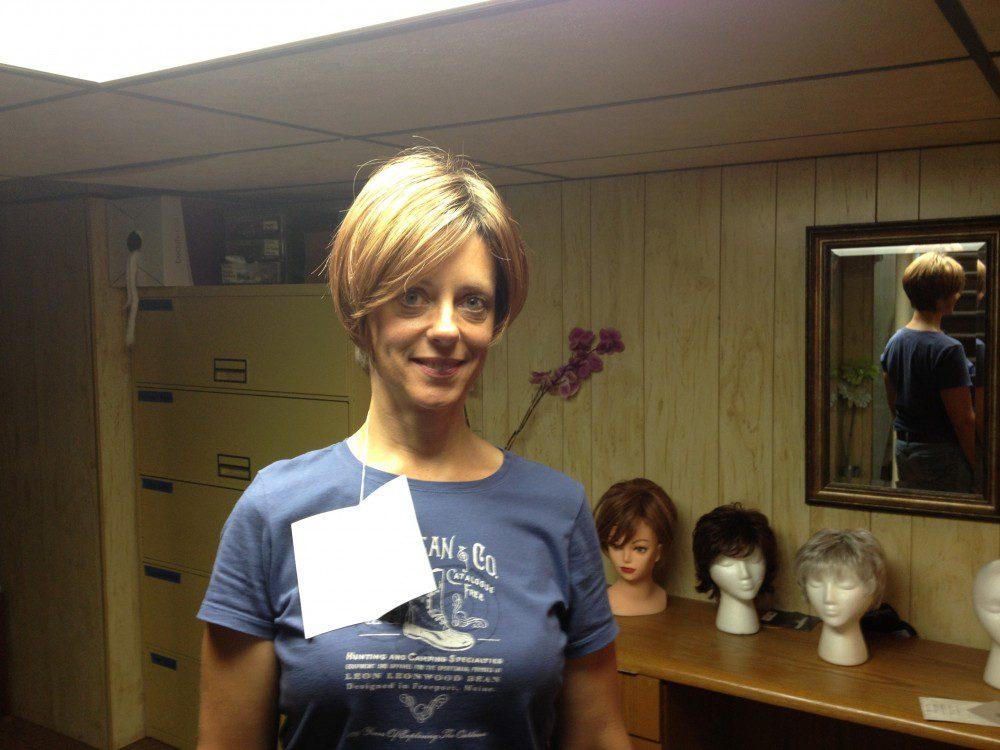 Amy Czerniec trying on cancer wigs