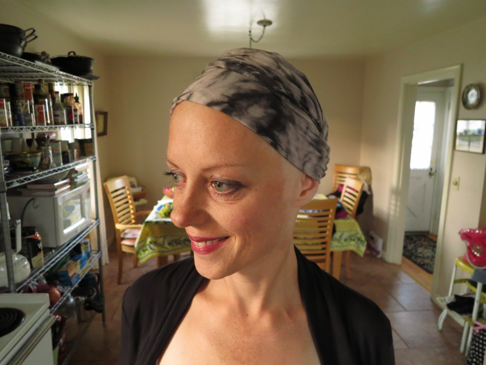 Amy wearing a head wrap during chemotherapy for breast cancer