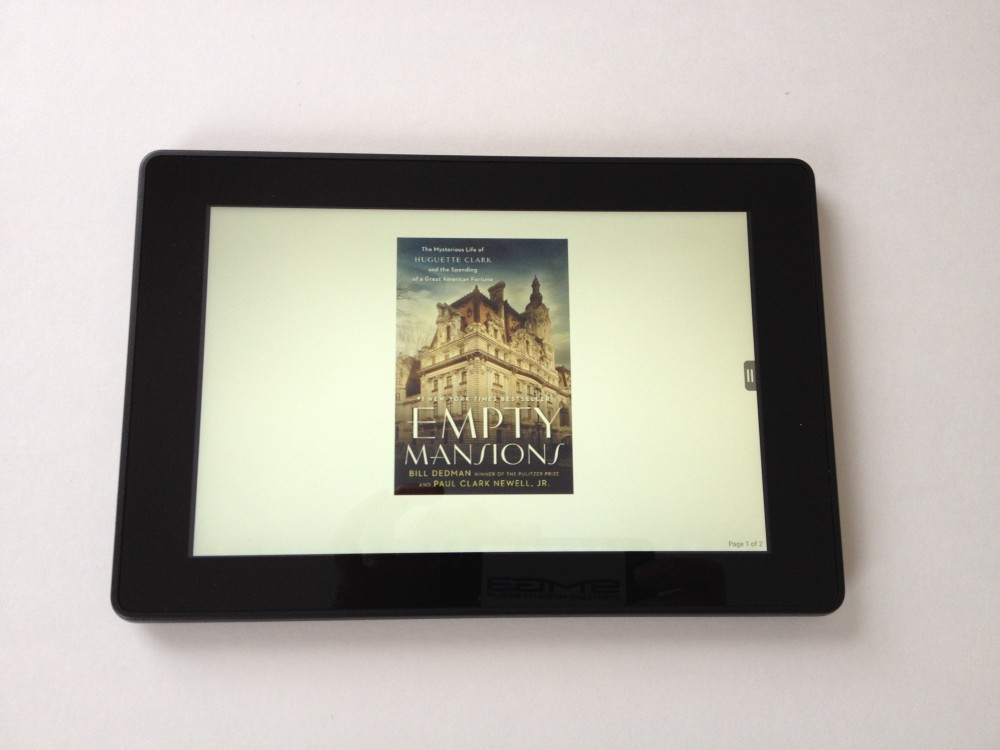 Kindle Fire HD, displaying the book cover of Empty Mansions by Bill Dedman and Paul Clark Newell Jr.