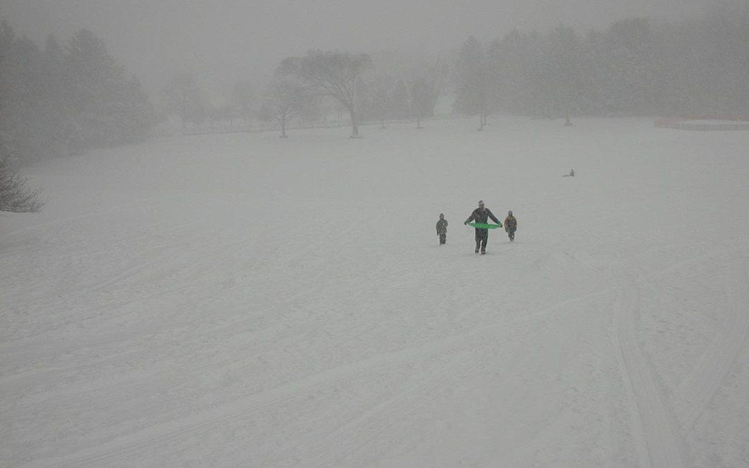 Sledding in a snowstorm