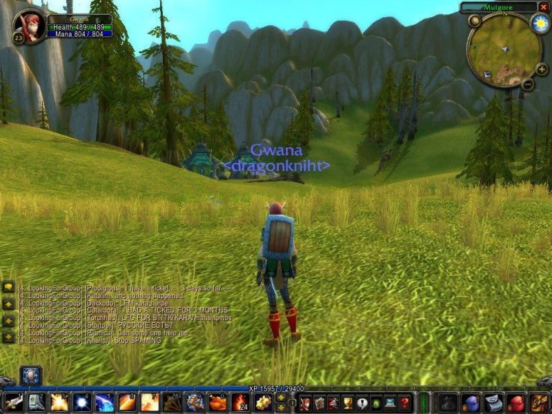 World of Warcraft (Burning Crusade) screenshot showing the exploration panel, chat window, available spells and actions, mini-map, and basic statistics
