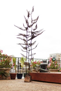 Kelp Commission - Huntington Beach, CA. Travertine base, hand forged steel stalks, bronze mess leaves