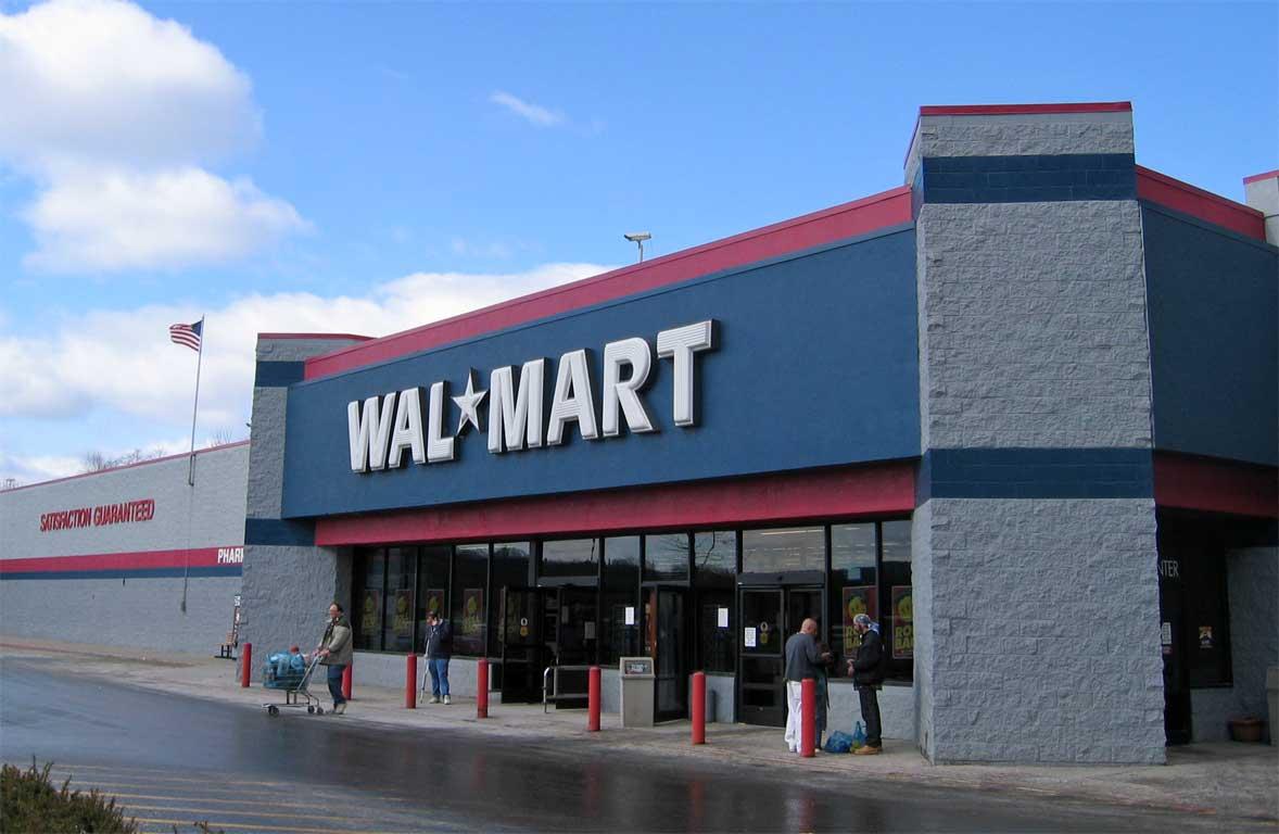 Walmart holiday quarter sales top estimates, shares rise