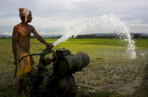 Farmer pumping groundwater