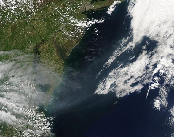Smoke billowing into the Atlantic Ocean