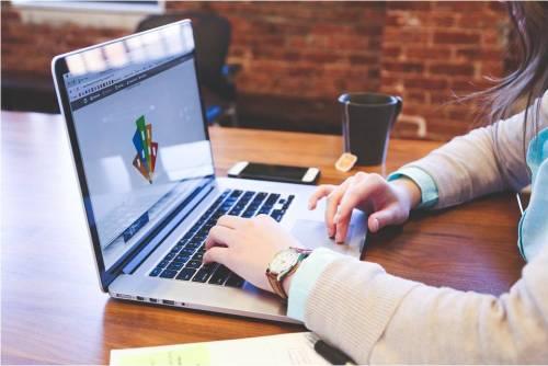 self-employed using laptop