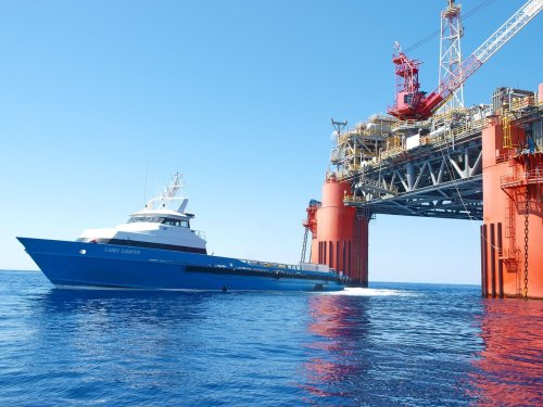 ship passing under sea structure