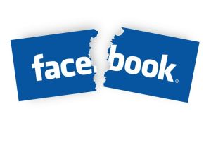 11817730 - concepts of quit facebook, by tearing the facebook sticker half.