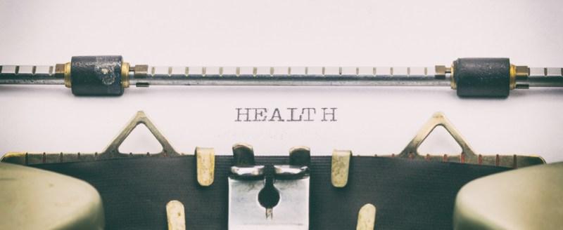Typewriter with written word 'health'.