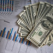 Image of US dollars with charts for the marketing tip on COVID-19