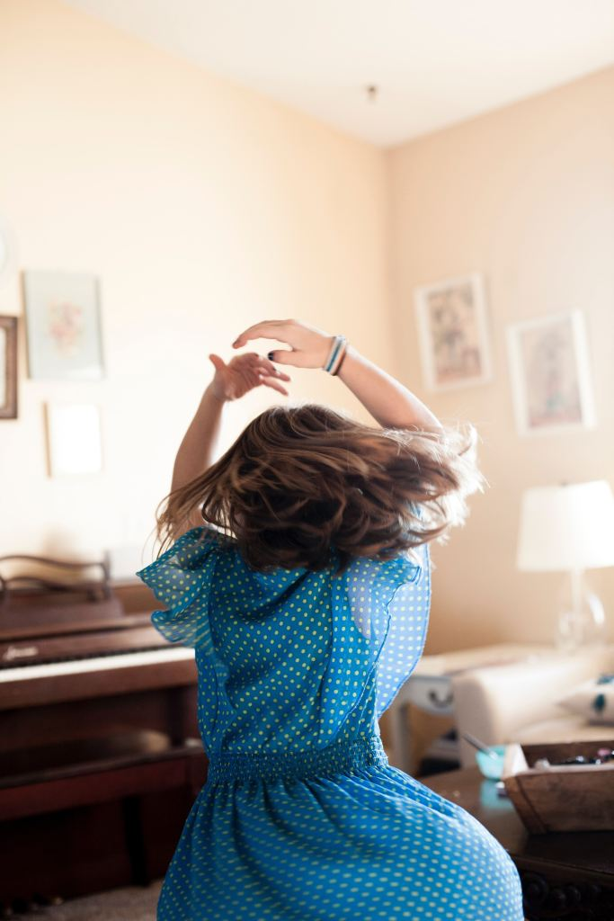 child dancing to music