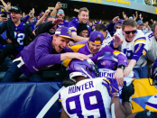 Minnesota Vikings players celebrating with fans