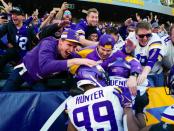 Minnesota Vikings players celebrating with fans