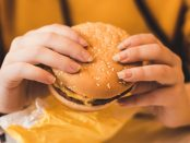 Someone eating a McDonald's burger.