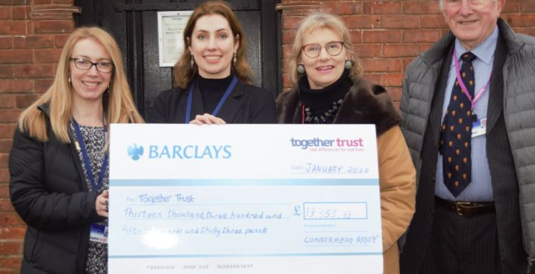 Stockport Charity Together Trust receives cheque for £13000 from Cheshire estate