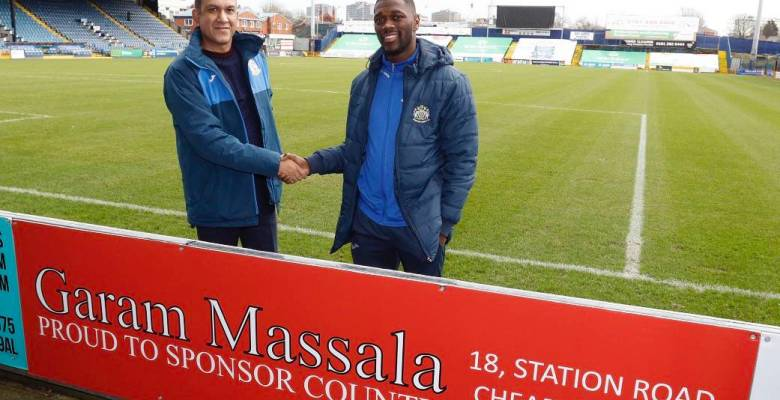 Garam Massala restaurant's new sign board at Stockport County's Cheadle End