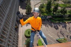 Abseilers descend Stopford House in aid of Mayor's Charity