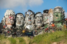 Mount Rushmore style sculpture depicting the G7 leaders made from electronic waste