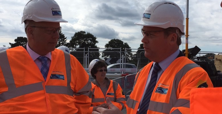 Chris Grayling in discussionwith Ken O'Toole, CEO Manchester Airport