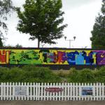 Fusion Signs and Graphics mural at Reddish South Station