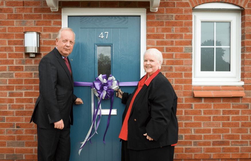 Shared ownership in Brinnington Picture: The official ribbon cutting by Philip Whitehead, Regional Regeneration Director for Countryside,and Councillor Sheila Bailey, cabinet member for communities & housing at Stockport Council.