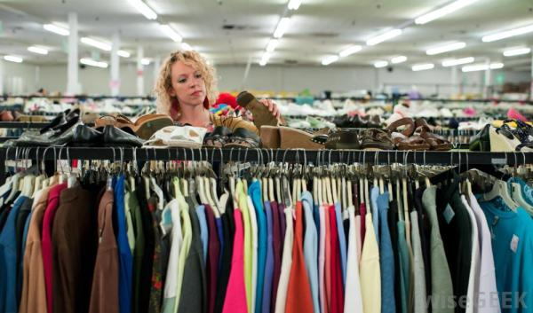 woman-shopping-for-clothing-in-thrift-store