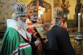 Vladimir Putin good Christian pays homage to the Patriarch Kirill the leader of the Russian Orthodox Church