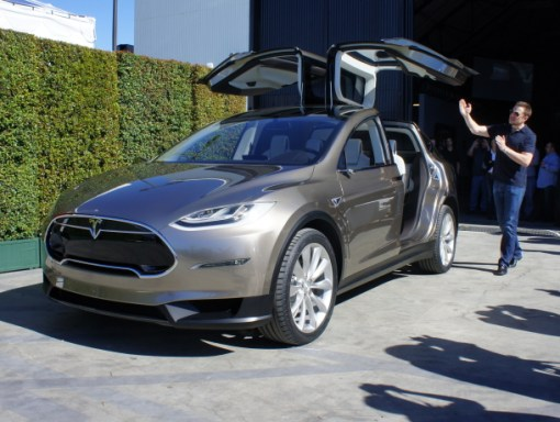 Elon Musk shows off a prototype of the Next Tesla the Model X.